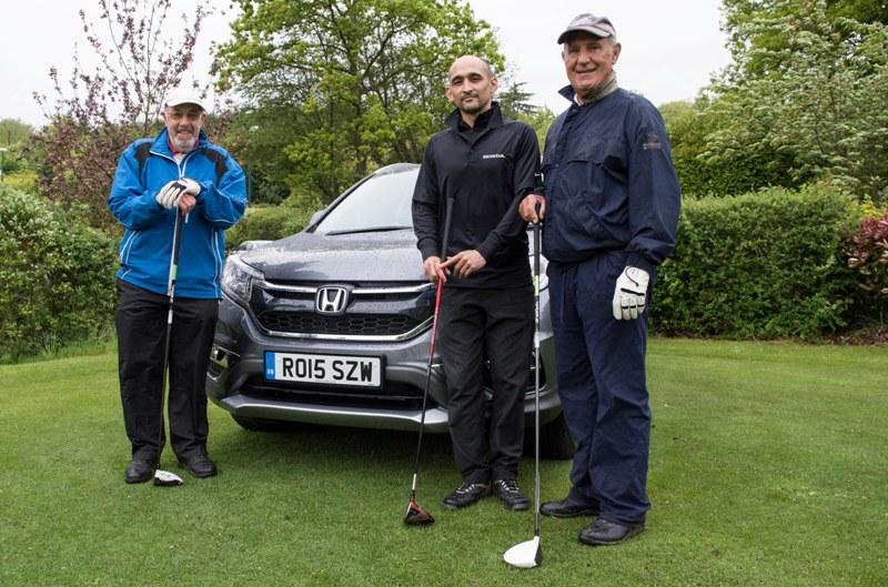 2015 Charity Golf Tournament  - Posing next to one of the new Honda cars on display. Honda also sponsored a special draw prize: a Honda car for a weekend trial.