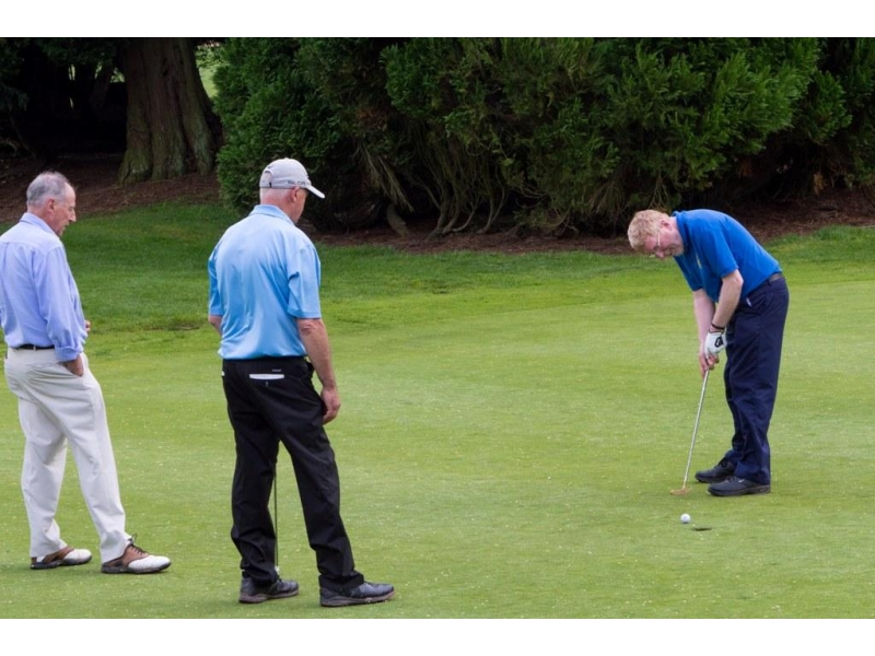 2016 Charity Golf Tournament  - Kevin taking a putt