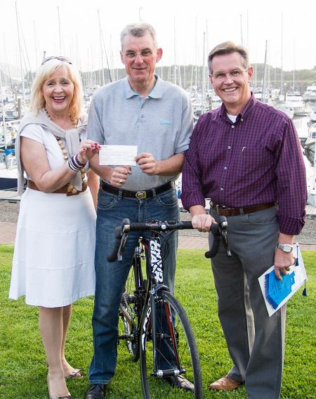David Attwood's cycle ride  - President Anne presents a cheque from Greenock Rotary to David Attwood. Also present is Gourock Rotary president Alex Murphy