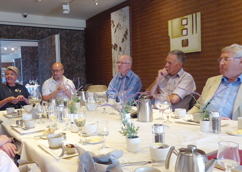 Club handovers - Members and partners enjoy the fellowship between courses.