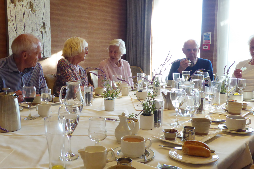 Club handovers - Enid Harper, widow of former member Rev Reg Harper enjoying the conversation around the table.