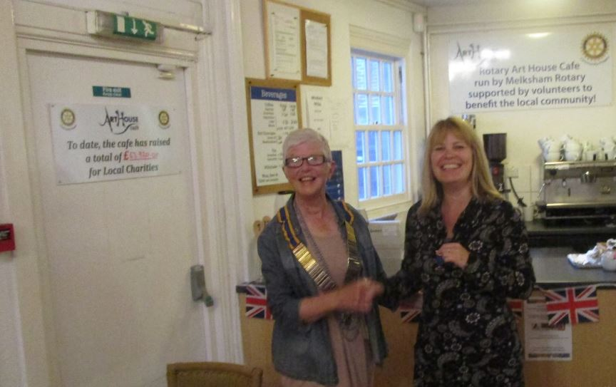 President for 2016/2017 - Verly gives Sarah a past presidents badge