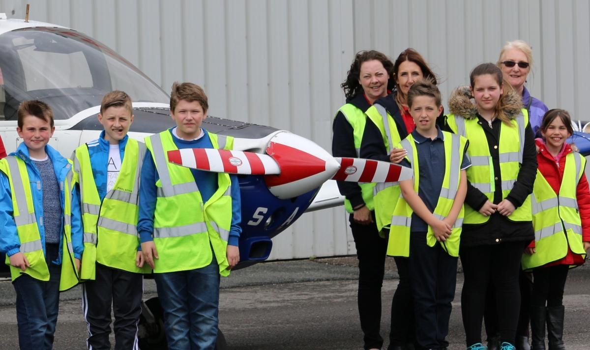 Rotary e-club of Aviation District 1010 - On the 21st May 2016 many of our members around the world hosted a young carers day out. Our picture shows six young carers on a day out at Liverpool Airport