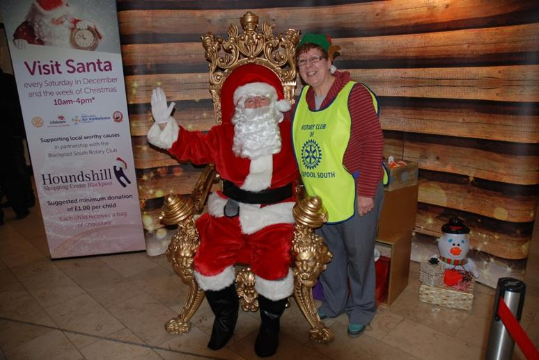 SANTA VISITS THE HOUNDSHILL CENTRE, BLACKPOOL - Santa with his own special happy Elf.