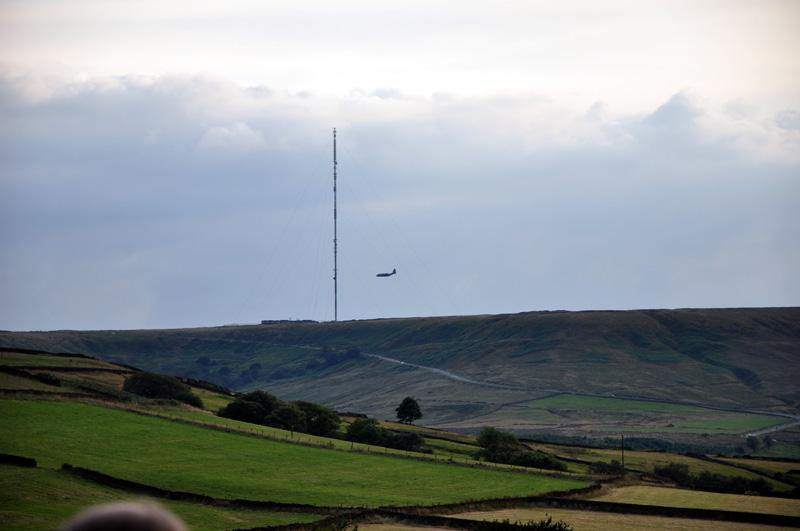 Outside Visit - Holmfirth Vineyard - Holme Moss view with an plane just passing.