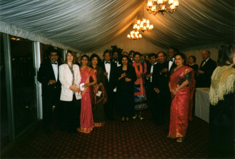 Club History - Rotarians and Guests gathered in a Marquee next to the River Thames for pre-Dinner drinks