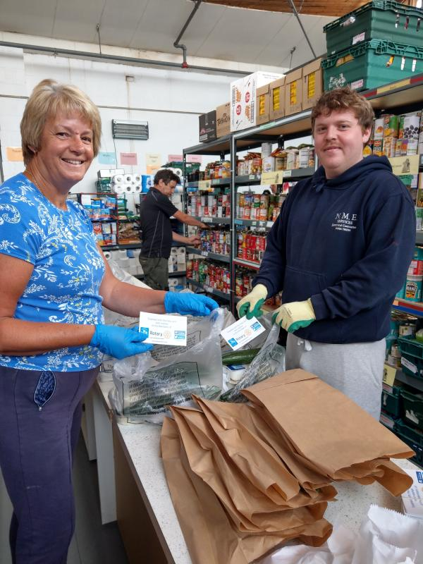 Rotary Becket Food Bank News - Team from Hope Centre food packages with our compliments cards