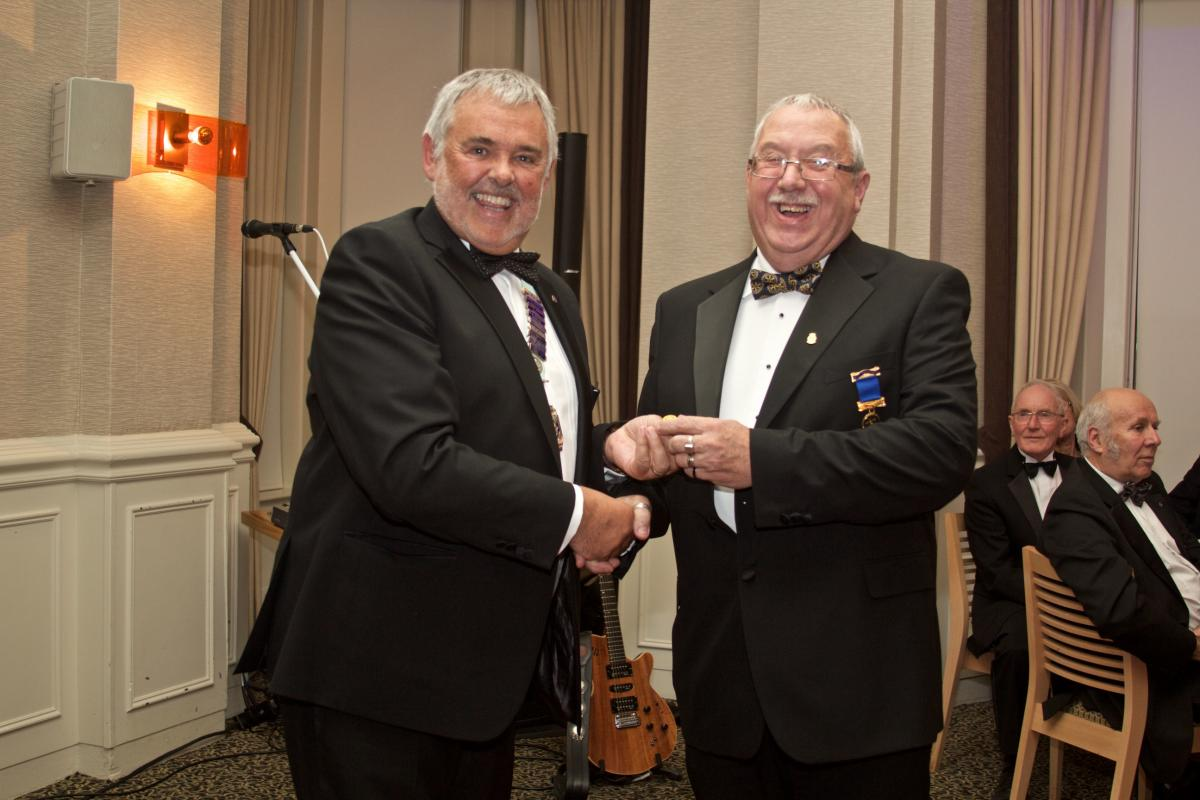Palatine 36th Charter Night - Gary Pretty receiving Paul Harris Award from DG Malcolm Baldwin