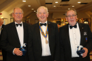 Holyhead Rotary Club 70th Charter Dinner - President Robyn Williams with his two club Secretaries, Rotarians David Winckle PHF and Michael Kenyon