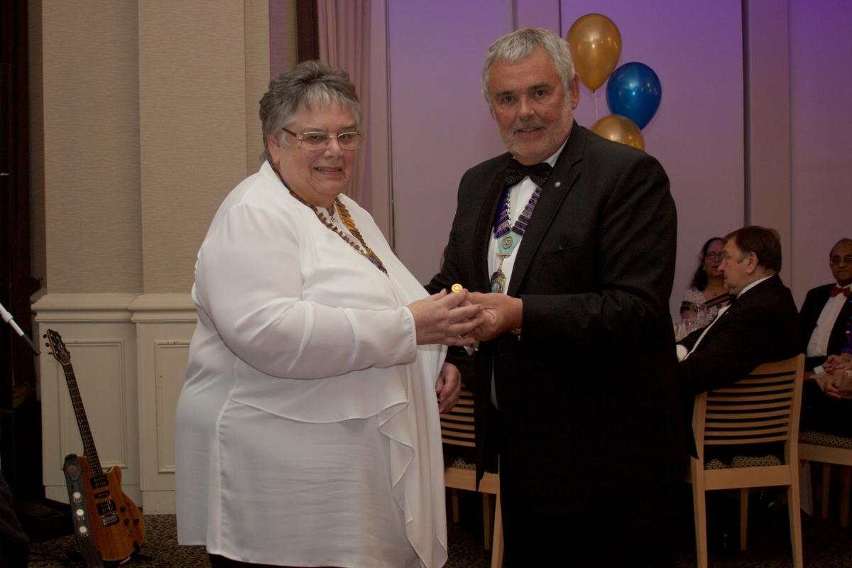 Palatine 36th Charter Night - President Gail receiving her Paul Harris award from DG Malcolm Baldwin