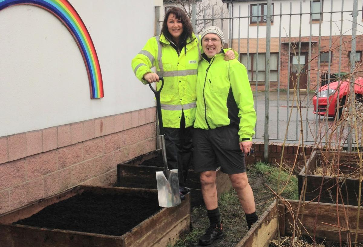 Glasgow Rotary E-Group (GREG) - Susan Wilson, Tesco Community Champion & Davy @ John Orr Day Care preparing flower beds with support from service users.