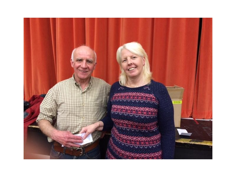 DONATIONS,  PRESENTATIONS AND OTHER SPECIAL OCCASIONS - Ken Garrod gives a donation to Pauline French of Brockenhurst Gateway Club while at the Bingo. The donation is for the GAMES on 1 October.