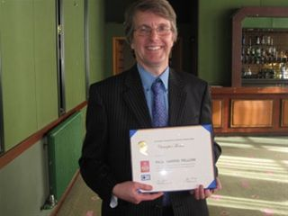 Christopher Thomas' PHF Presentation - Chris shows off his Paul Harriss Certificate.