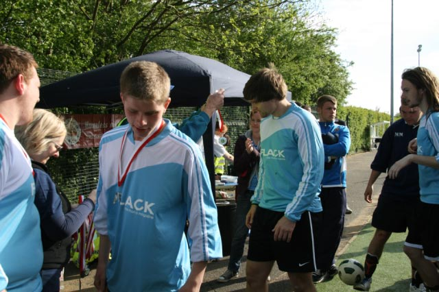 May 2012 Tommy McLafferty Football Tournament for Homeless communities - Flack players receiving their medals