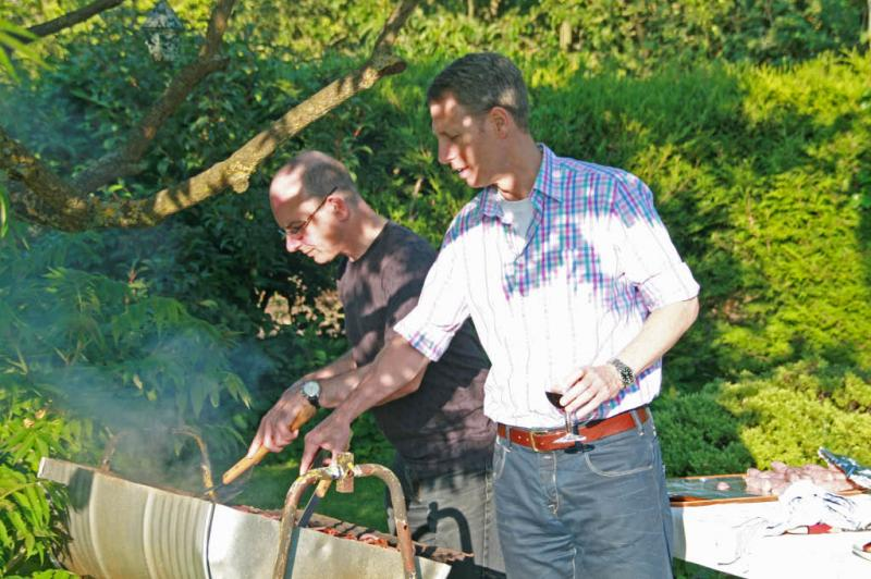 Jun 2012 Club Barbeque - Harlton (no meeting at the University Arms) - Michael and Duncan the new chefs on a bright sunny evening, yes, we get get a few in 2012.