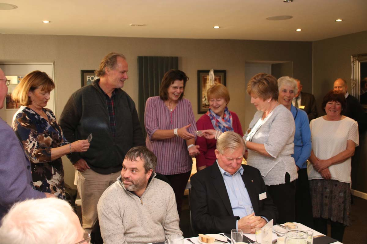 Friends of Ilfracombe Rotary - Helen Webb presents the Friends with their name badges, club directory and Hi-Viz tabards.