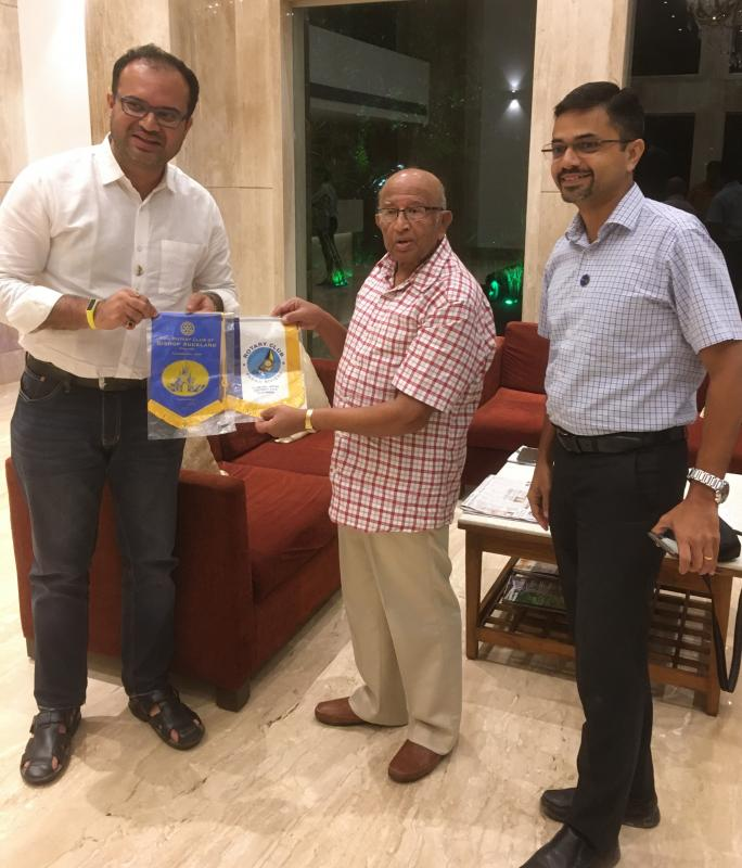 Banner exchange with Kishor Velangi and Bill Robson -