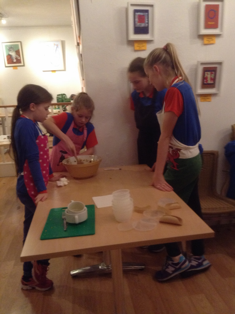 Guides make Christmas puddings for elderly people  - Guides making puddings