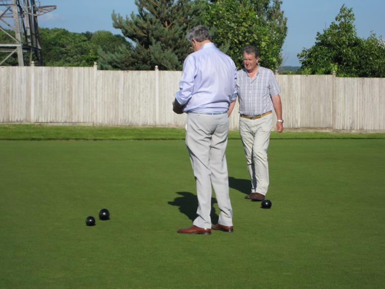 BLACKPOOL SOUTH ROTARY CLUB CROWN GREEN BOWLING COMPETITION - 2014 - Ron has to wait for Barry to come up to double to check the position of the bowls. Lovely rivalry.