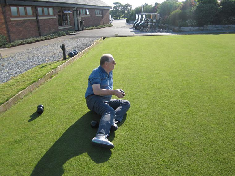 BLACKPOOL SOUTH ROTARY CLUB CROWN GREEN BOWLING COMPETITION - 2014 - He allegedly fell but we think it was tactics - checking the level of the green.