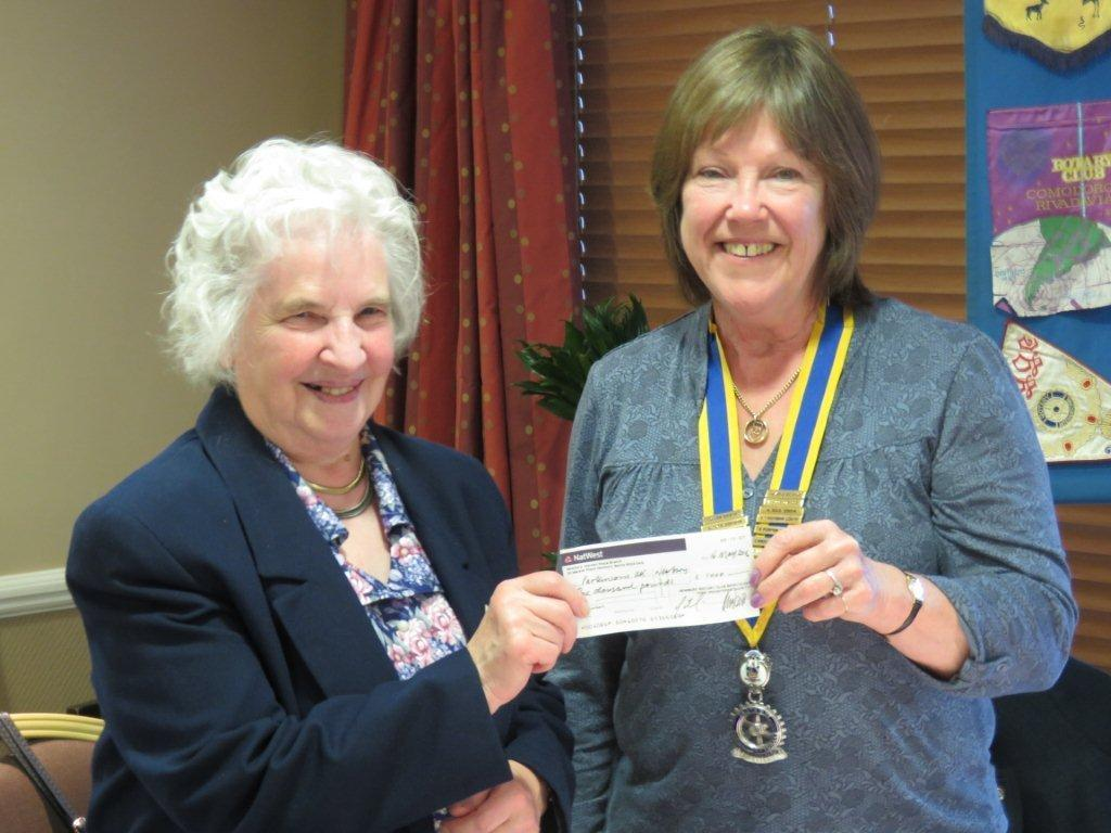 Mary Hansford presented with the Paul Harris Award - receiving a cheque for £1000 for Parkinson's UK (Newbury and District Branch). the funds were raised at the recent Newbury Rotary Charity Golf Day.
