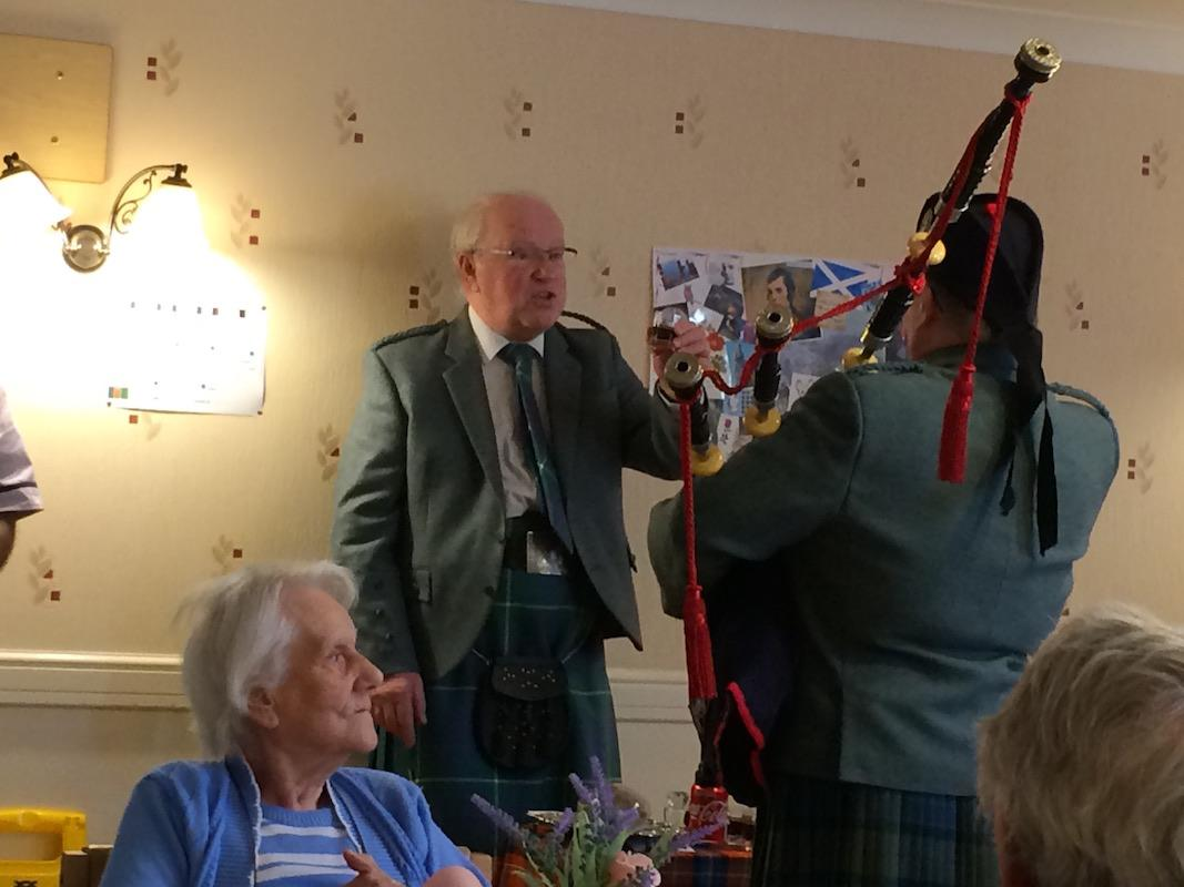 Scottish Lunch Tor-Na-Dee Care Home, 30Jan17 - Ken welcomes the Piper.