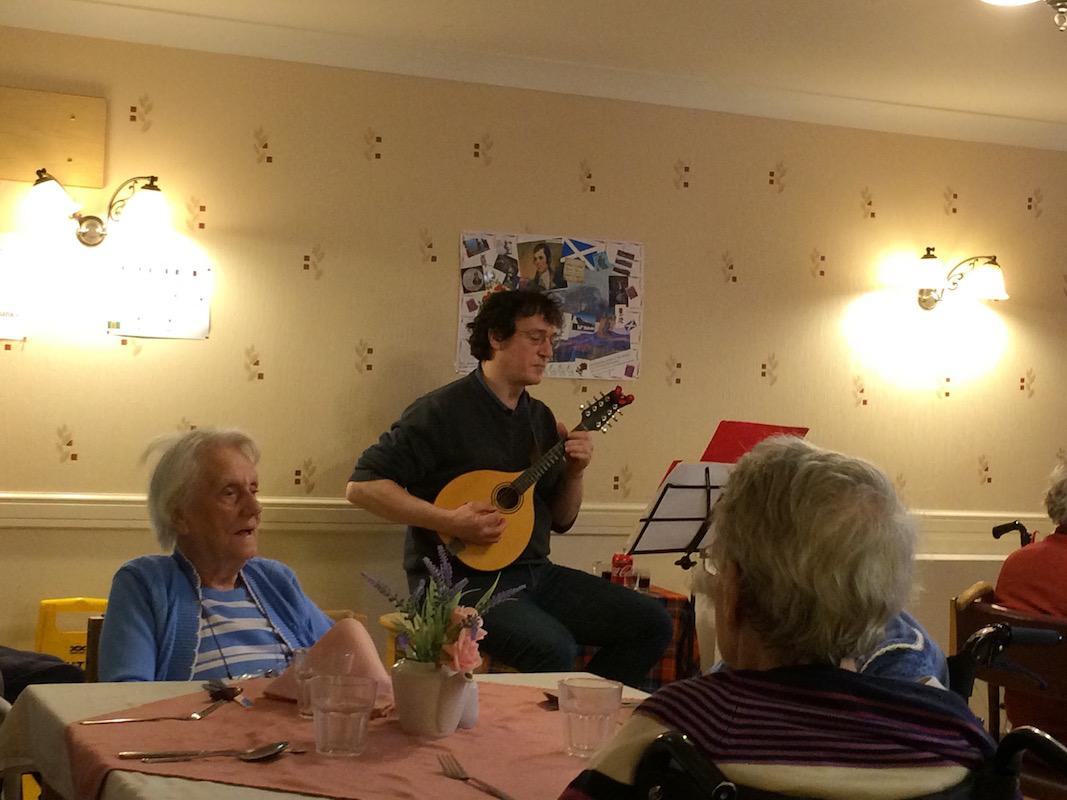 Scottish Lunch Tor-Na-Dee Care Home, 30Jan17 - Ken's Son playing Mandolin.