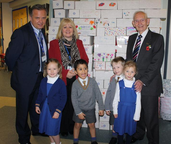 What we are doing internationally - Pupils at Lady Barn House School in Cheadle have filled 400 Rotary Shoeboxes and here are some of them being handed over to Honorary Rotary Ken Smith by Mrs S Marsh, Head teacher, Deputy Head Dan Slade and a few of the pupils.