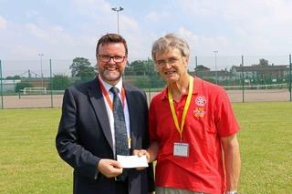 Defibrillator For All Saints Academy - Incoming Rotary President David Price with Principle Dermot McNiffe