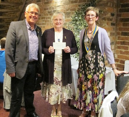 President's Night and 25th Anniversary of Charter Celebration - President Penny Thurston has just presented a cheque for £5735 to Elizabeth Philip and John Baden of the Holly Trust.