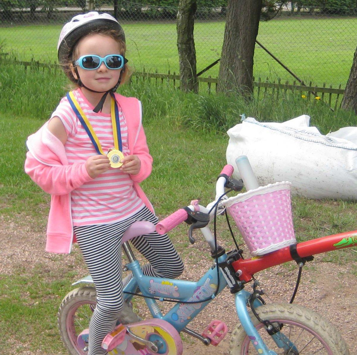 Rotary Cyclofun 2016 - One of our proud medal winners after finishing her circuit of Tentsmuir Forest