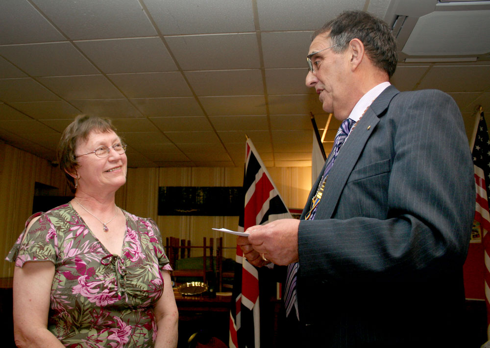 President's Changeover Night 4 July 2011 - Tony presents a Cheque to Ros for Epilepsy Bereavement