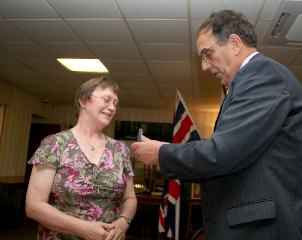 President's Changeover Night 4 July 2011 - Past President Tony presents the President's Lady's medal to Ros