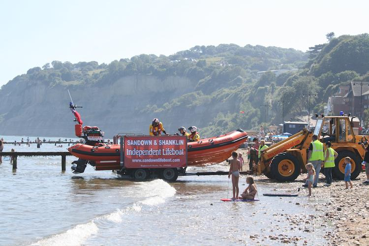 Shanklin Beach Regatta Photos  - Sandown Shanklin Inshore Lifeboat doing a display with the coastguard helicopter