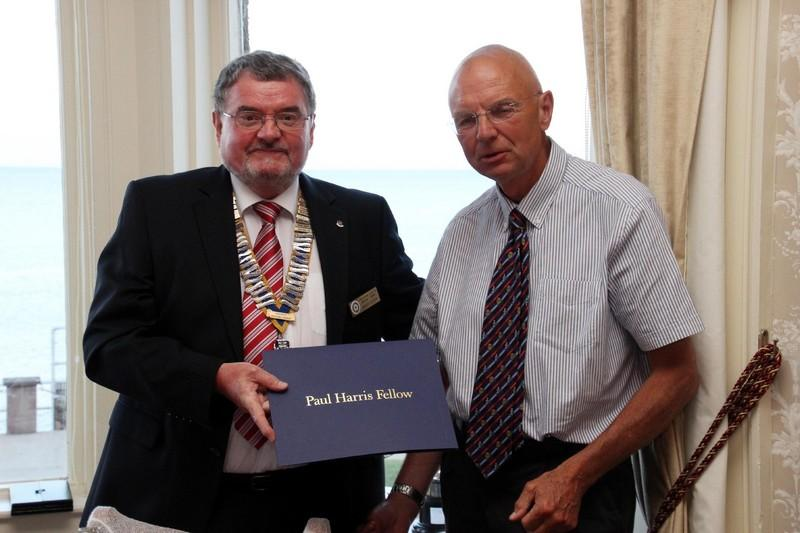 Recent Events - Presentation of Paul Harris Fellowship to Mic Christmas by Retiring President Roger Cutler