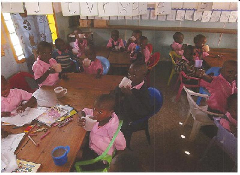 Our Work in Kenya - One kindergarden class having their porridge.