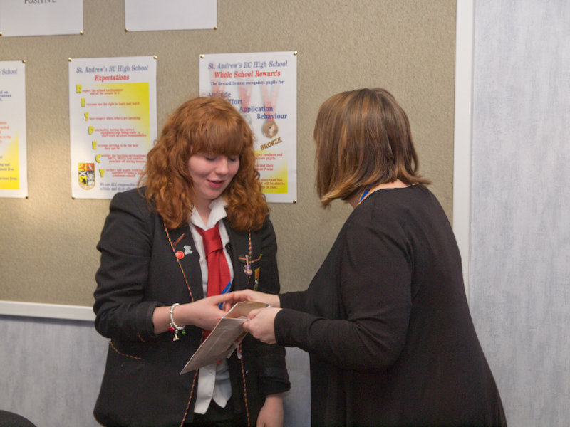 St Andrews RC HS Interact Club Charter - Kirkcaldy Riath President Tracy McCallum presents the Interactors with their badges