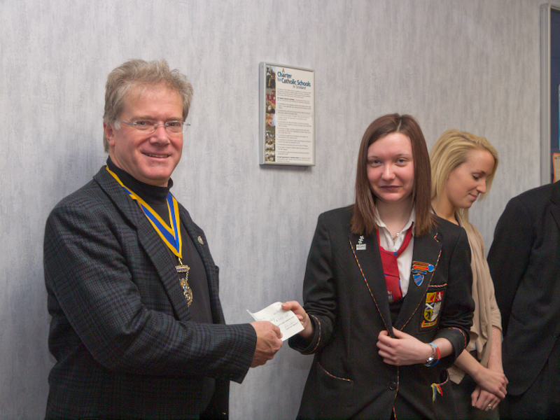 St Andrews RC HS Interact Club Charter - President Iain accepts a cheque from the Interactors for our Tanzanian projects