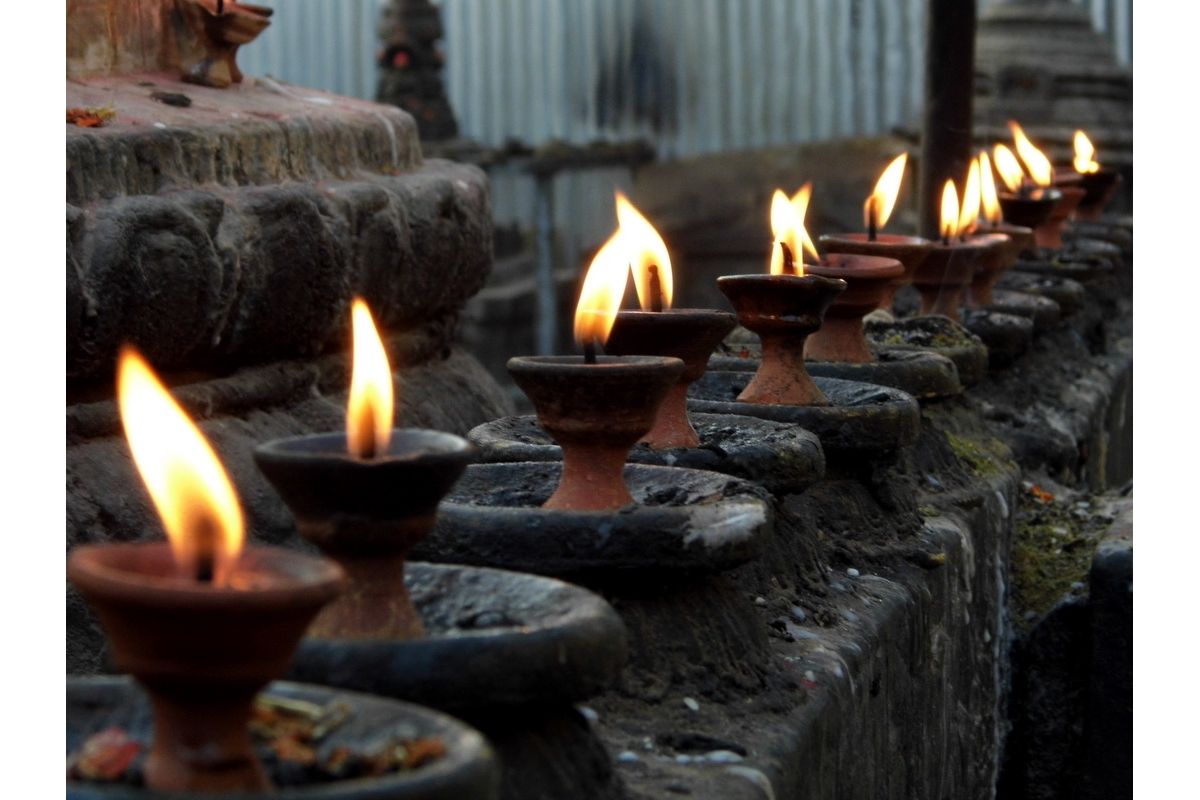 2017-18 Young Photographer Results - Swayambhunath, Kathmandu.  Each flame is individual, but they join as a group.