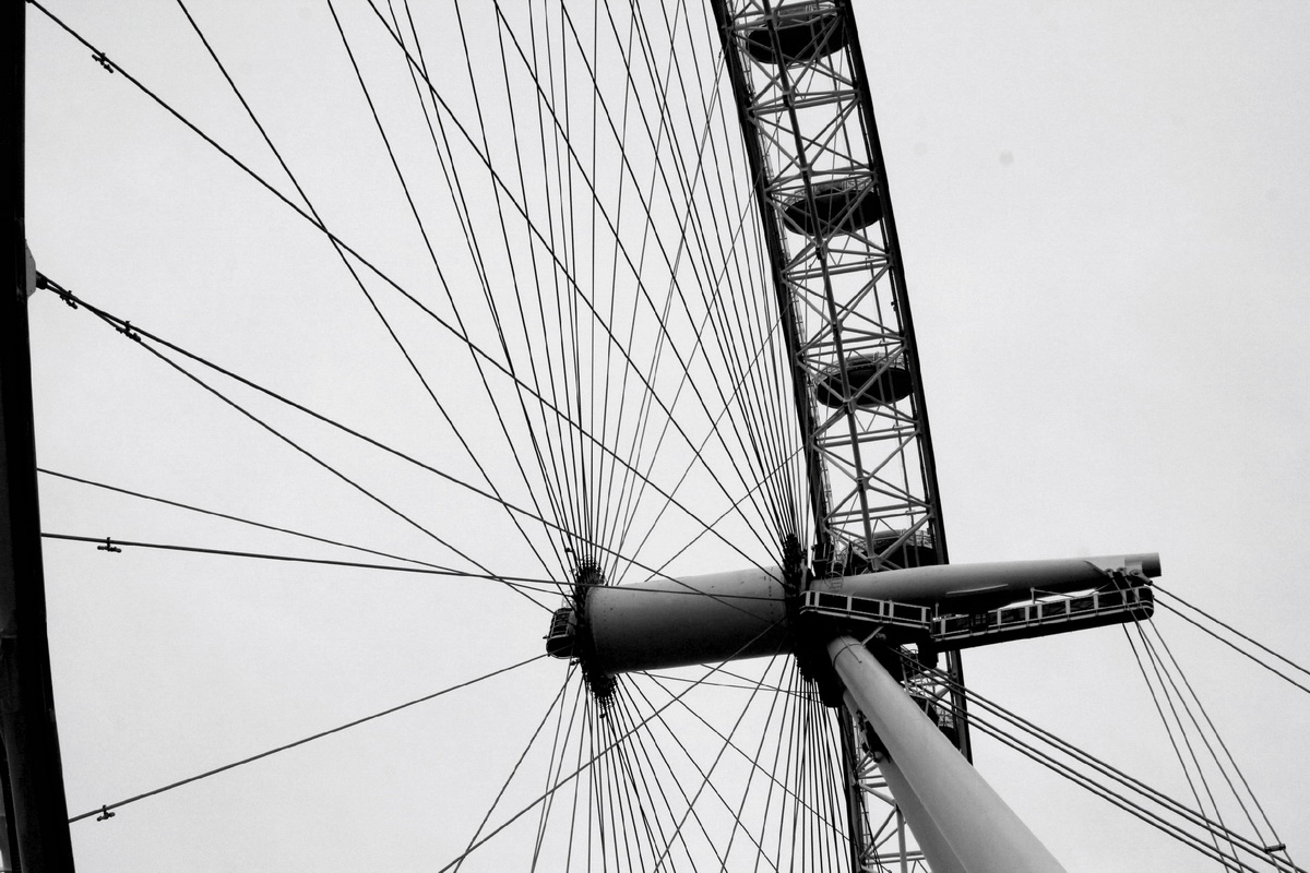 2017-18 Young Photographer Results - The central part of the London eye. I converted this into black and white in PicsArt, to make the contrast between the spokes of the Eye and the clouds look better. I think this fits the brief because most picture of the London Eye have the whole thing an