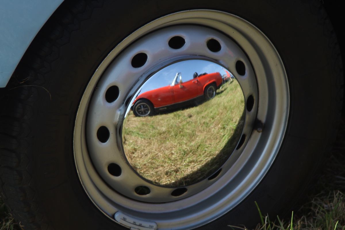2017-18 Young Photographer Results - I was walking around Morval vintage rally and I saw the reflection of a vintage car in the car wheel. I like the bright colours and the quality of the reflection, and the only editing I did was cropping, to exclude the rust, which I found distracting.