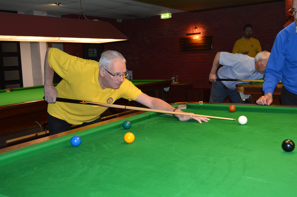 Annual Snooker Match v Abbeydale Rotary Club - John goes for a pot.