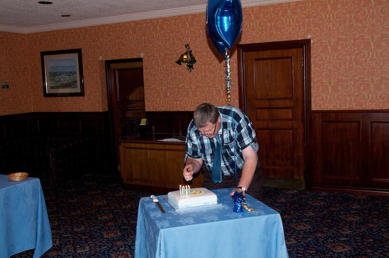 Cowdenbeath Rotary Club celebrates its 90th birthday. - Jim Stark successfully lights the candles without burning his fingers.