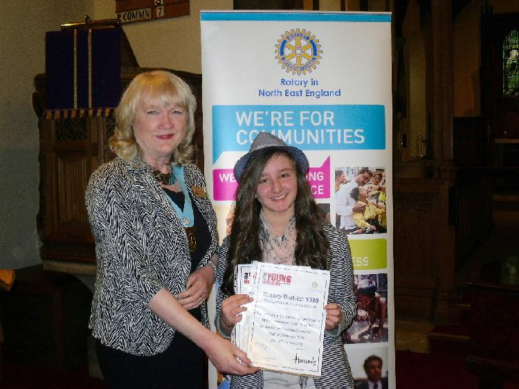 Young Musician 2015 - District Final - Jasmine Elliott, runner-up in the instrumentalist category, receives her certificate from DG Jean Thompson