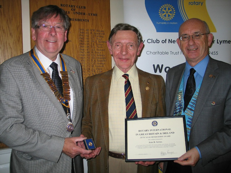 Lunch Meeting - 50 Year Membership Celebration - John receiving his 50 Year Rotary Membership Award from District Governor Barry Preen (right) and Sapphire Pin from Club President Joe Cartwright (left).