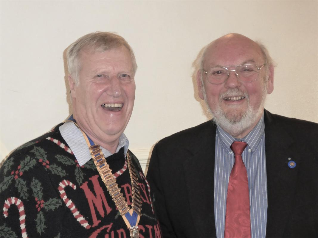 Christmas Lunch - John Crowe receiving his Paul Harris Fellowship from President Michael