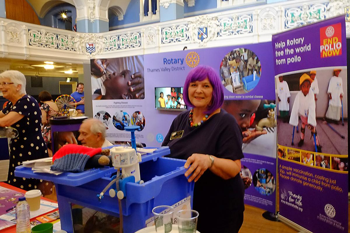 Turning Purple for Polio at Oxfordshire Science Festival - District Governor Joy Arnott leads the way, explaining how each immunised child receives a purple mark on their pinky (small finger)