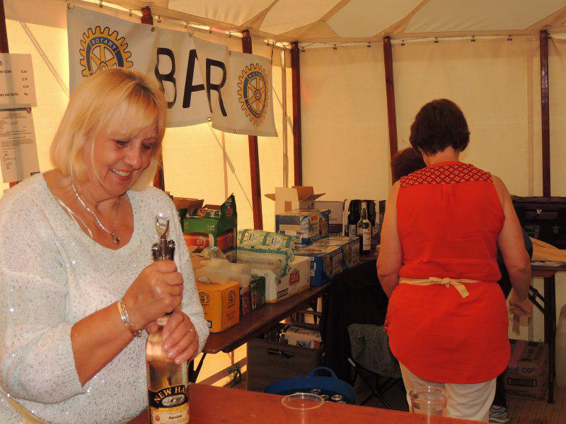 Toot Hill Show 2013 - June pulling the cork from a good English wine
