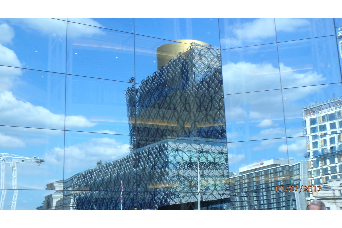 2017-18 Young Photographer Results - This photo is a reflective, fractured perspective of two buildings looking at one. The buildings are in Birmingham.