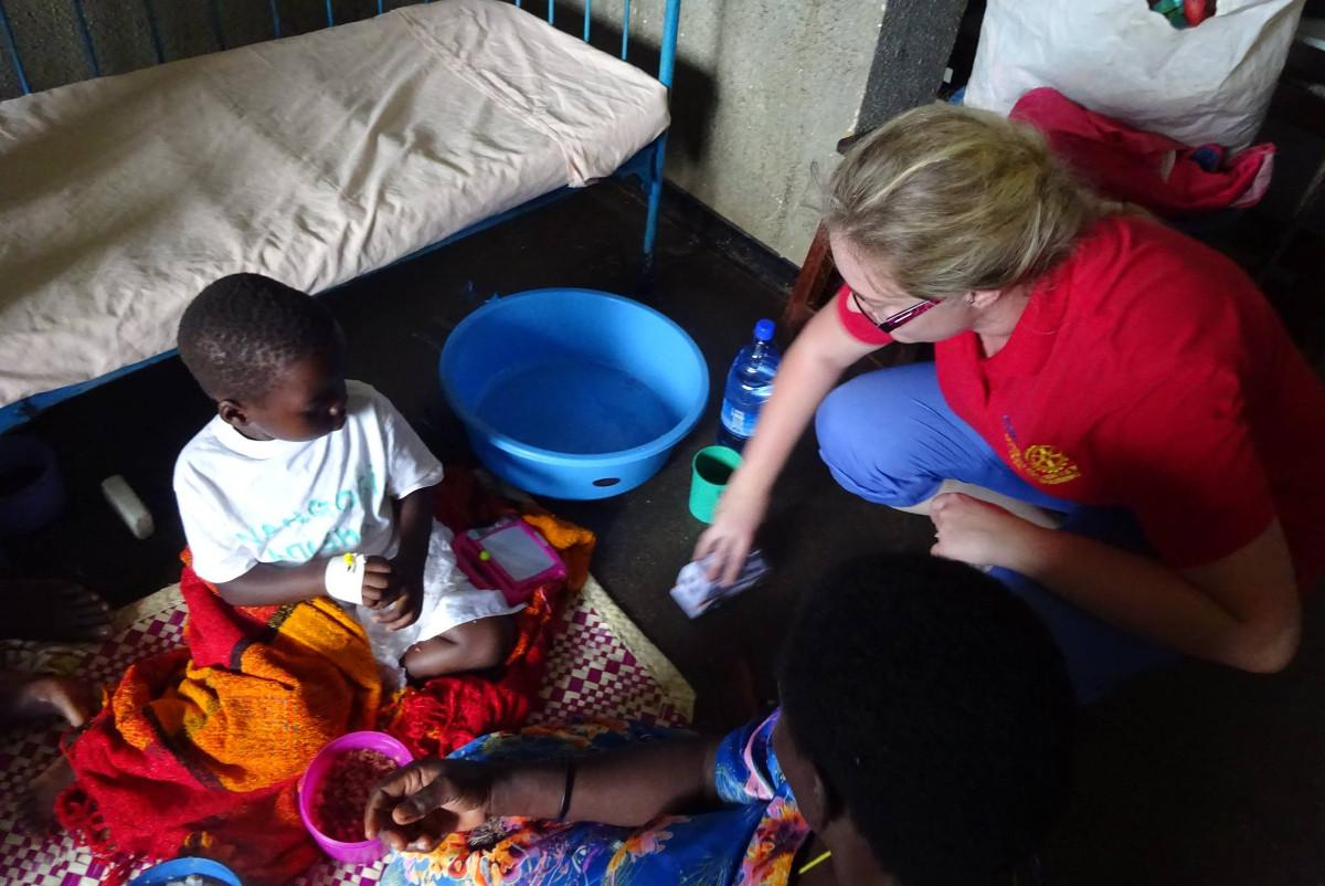 Kamuli Mission Hospital - April 2015 - sharing out toys on the children's ward